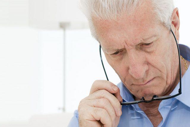 Eye doctor, senior man having difficulties reading in Roanoke, VA