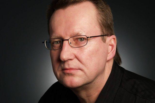 Eye doctor, middle aged man suffering from presbyopia in Roanoke, VA