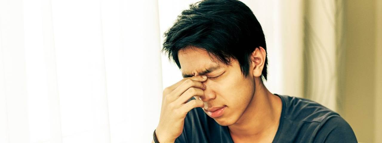 Young man suffering from Dry Eye Syndrome