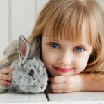Blue-eyed girl, with rabbit