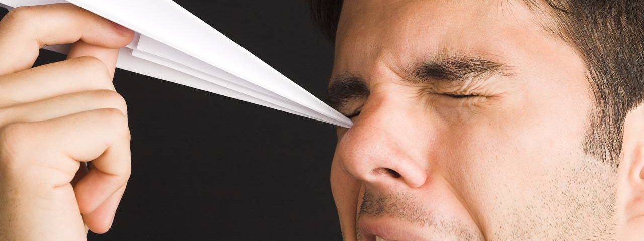 Optometrist, man pocking his eye with a paper airplane in Louisville, LaGrange & Carrollton, Kentucky