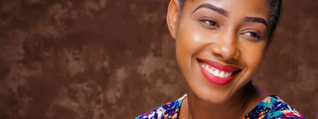 Optometrist, african american woman smiling, wearing contact lenses in LaGrange, Carrollton, Oxmoor, & Springhurst, Kentucky