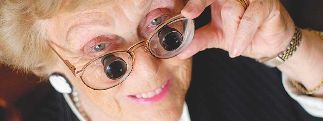 Eye doctor, senior woman wearing low vision eyeglasses in Louisville, LaGrange & Carrollton, Kentucky