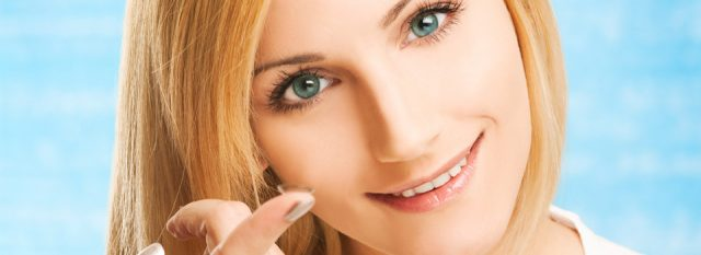 Optometrist, woman holding a GP contact lens on her fingert in LaGrange, Carrollton, Oxmoor, & Springhurst, Kentucky