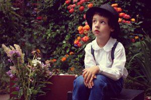 Boy Hat Sitting Garden 1280×853
