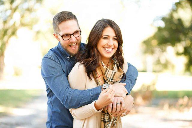 Woman wearing scleral lenses, with boyfriend in eyeglasses