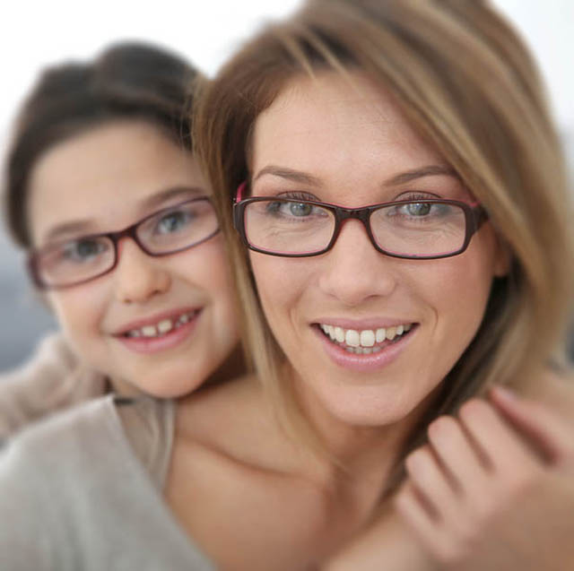 Portrait of mother and daughter with eyeglasses