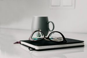Optometrist, pair of eyeglasses on a notebook in Copperas Cove, TX