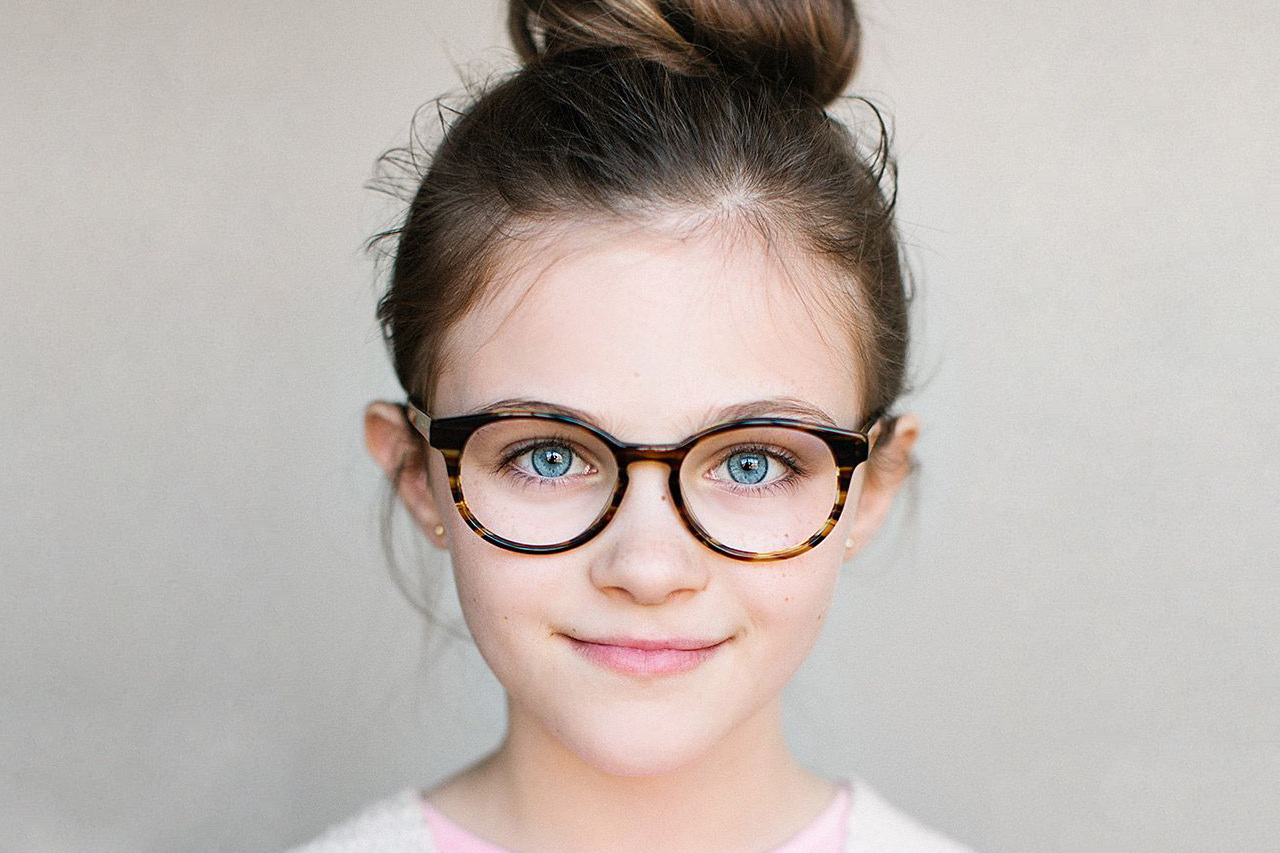 Girl with Jonas Pauley designer frames in Marion, Indiana