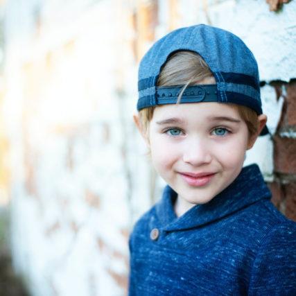 Girl wearing blue baseball cap 640.jpg