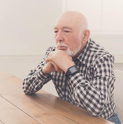 eye care, Man with Macular Degeneration, thinking