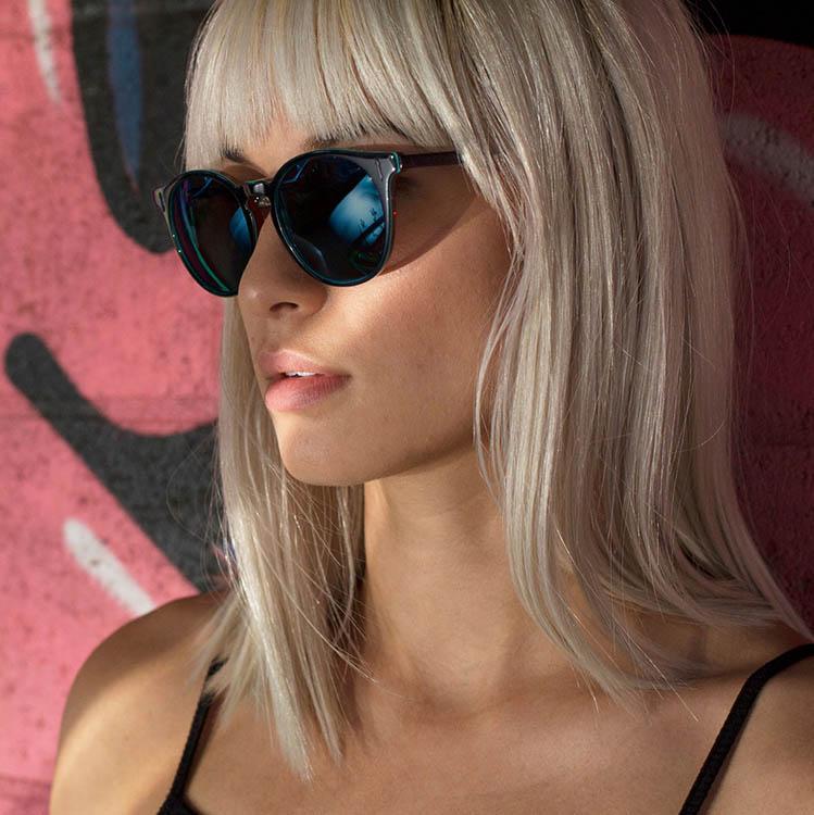 woman wearing designer sunglasses in Woodside, New York