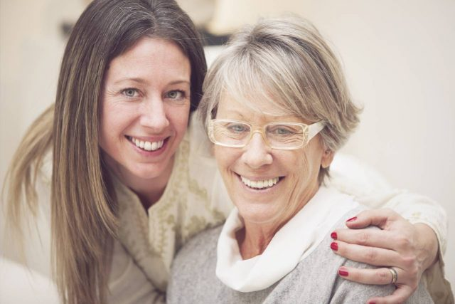Older lady with Diabetic Retinopathy, posing with her adult daughter