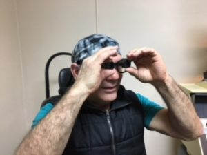 low vision patient with telescopes