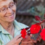 eye doctor, smailing senior woman with flowers in Fort Worth, Texas