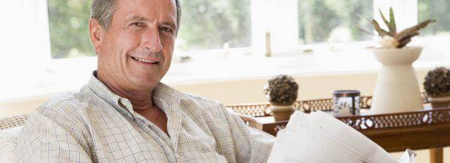 Optometrist, senior man holding a newspaper in Rocky Hill, Uncasville, Newington & Mystic, CT