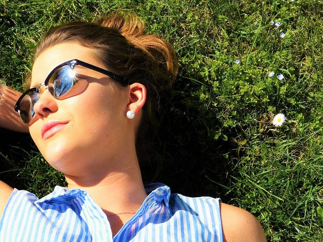 Woman Sunglasses Laying on Grass at TotalVision in Connecticut