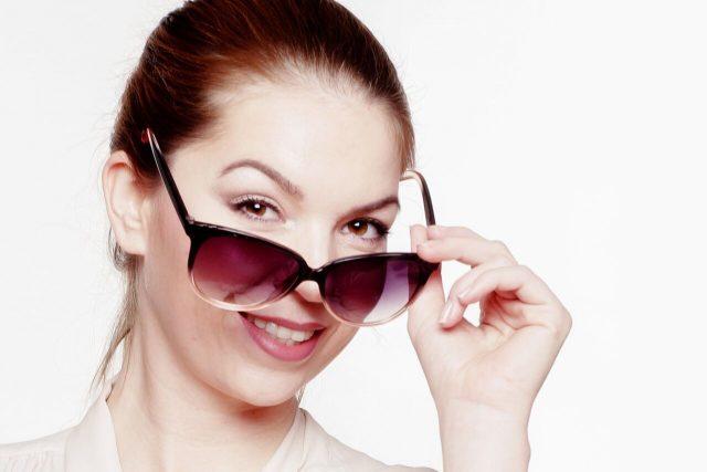 Woman wearing prescription sunglasses  at TotalVision in Connecticut