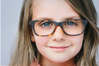 Optometrist, little girl wearing eyeglasses in Lombard, IL