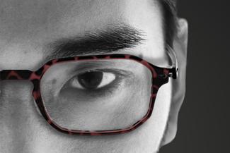 Eye doctor, asian man wearing prescription eyeglasses in Lombard, IL