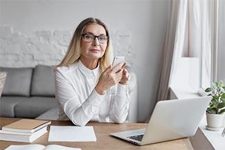 Optometrist, woman wearing computer glasses in Lombardi, IL