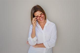 Eye doctor, woman wearing red eyeglasses in Lombard, IL