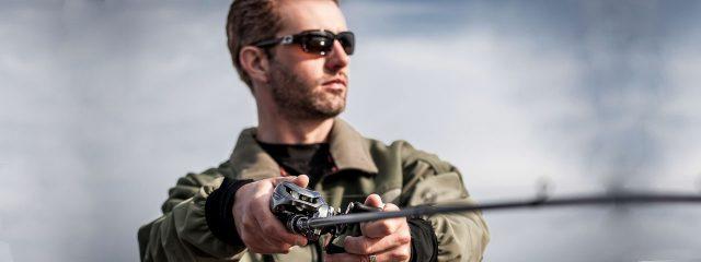 Eye doctor, man fishing wearing specialty sunglasses in Walla Walla, Washington