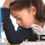 child frustrated at school because of poor vision. Ad: Click here to Take our vision quiz