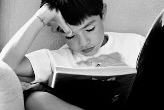 boy having difficulties reading
