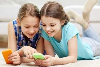 girls browsing a smartphone 325