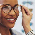 woman trying on glasses, designer eyewear at True Vision Eye Care in Morrisville, North Carolina