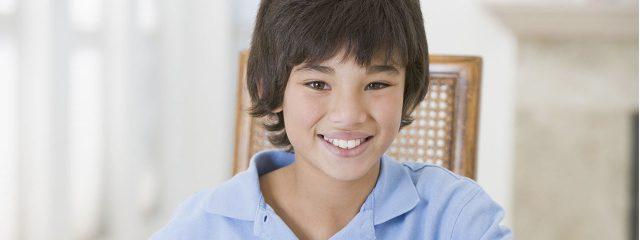 Eye doctor, asian boy smiling in Plano, TX