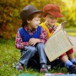 little boys reading a book