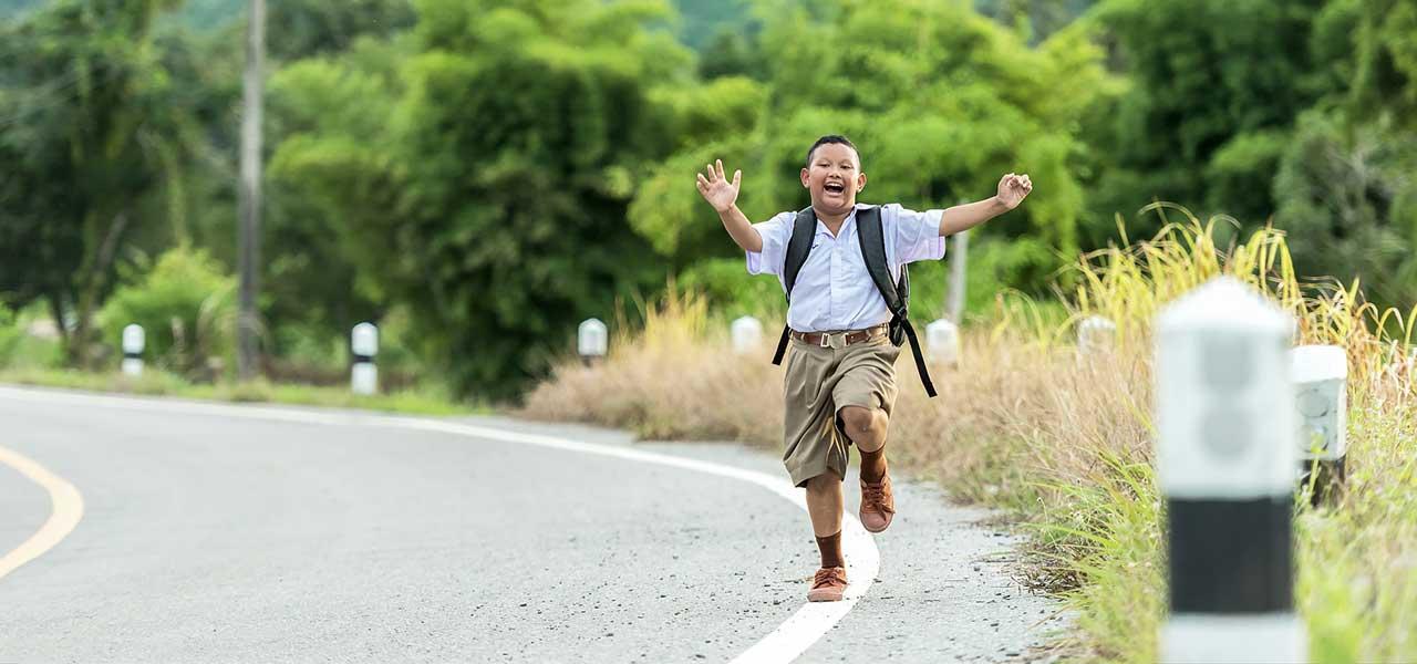 little boy on the road