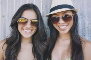 Two cute latina girls smiling at camera
