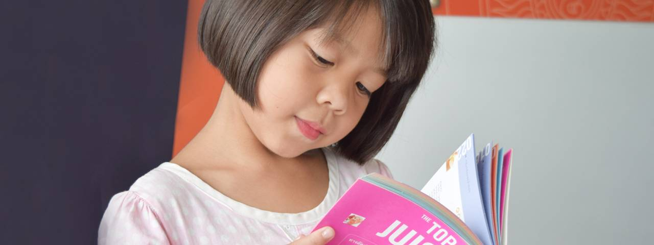 Optometrist little girl reading in Long Grove, IL