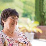 optometrist, senior woman wearing glasses after CXL for keratoconus in Long Grove, Illinois