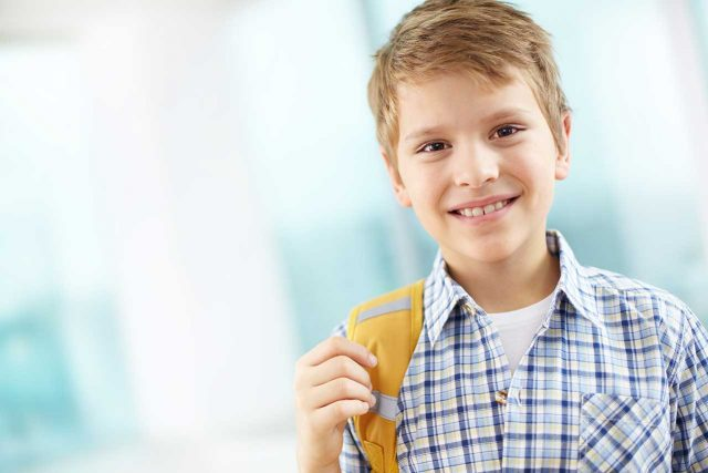 eye doctor, Boy on his way to school, wearing contact lenses for myopia control in Long Grove, Illinois