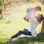 Eye doctor, pregnant woman holding her daughter in Edmonton & Sherwood Park, Alberta
