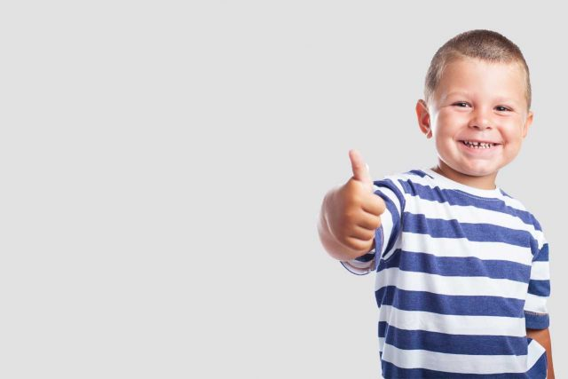 liitle boy giving thumbs up