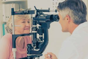 Eye doctor, senior woman at an eye exam in Kelowna, BC