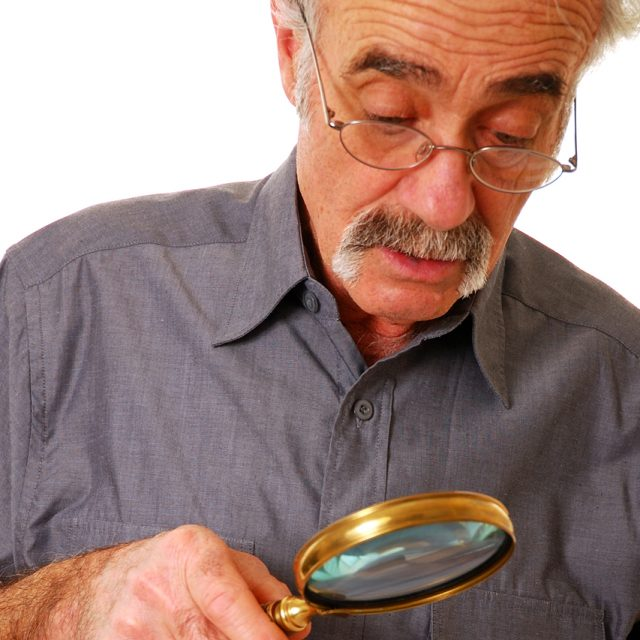 Senior-Man-Magnifying-Glass-640x640