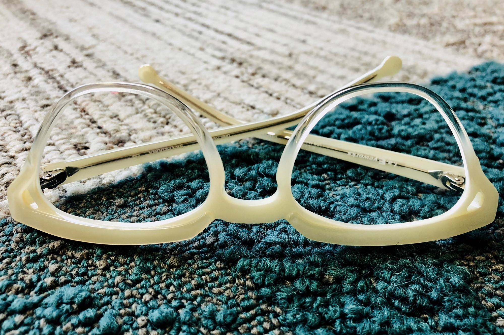 cream colored eyeglass frame