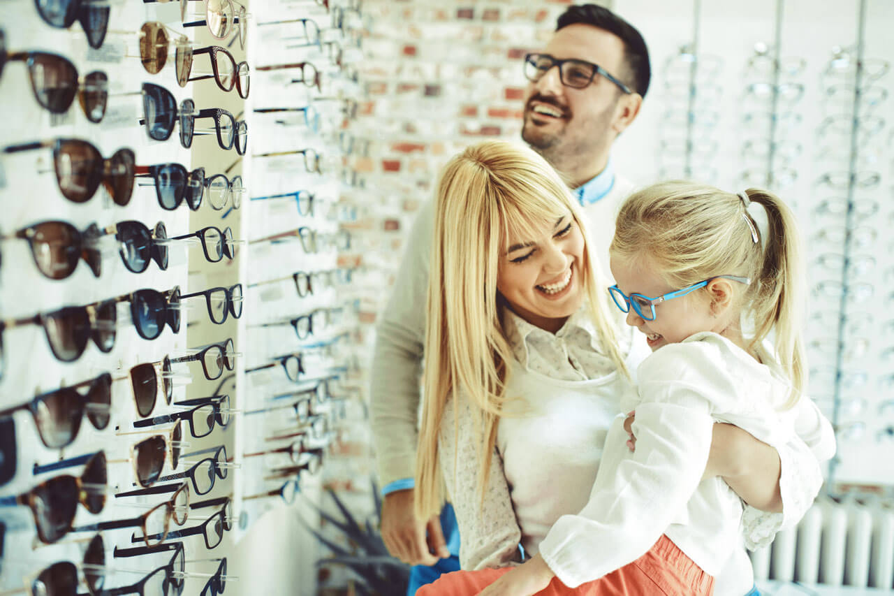 Family wearing glasses and contact lenses in Mallard Eye Care