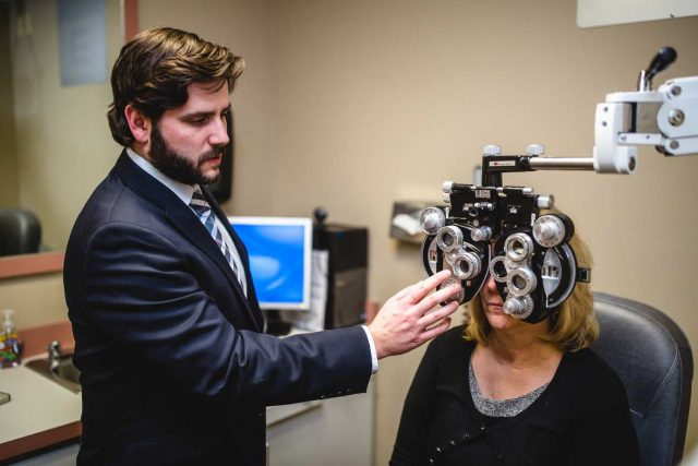 Woman having eye exam - optometrist - Heath, Newark & Grandville, OH