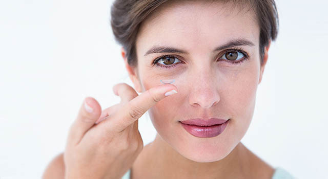 Woman Holding Contact Lens on Finger in Billings, Montana
