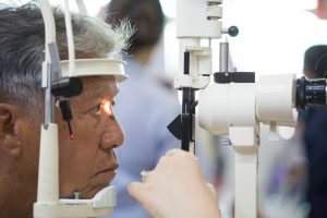 Senior man having eye examination