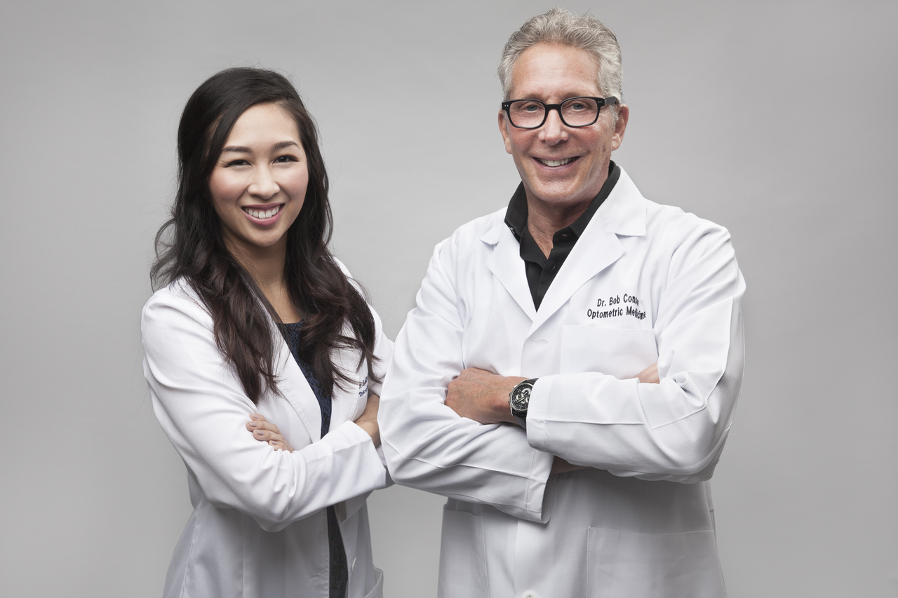 Smiling doctors standing beside each other, Optometrist in Dallas, TX