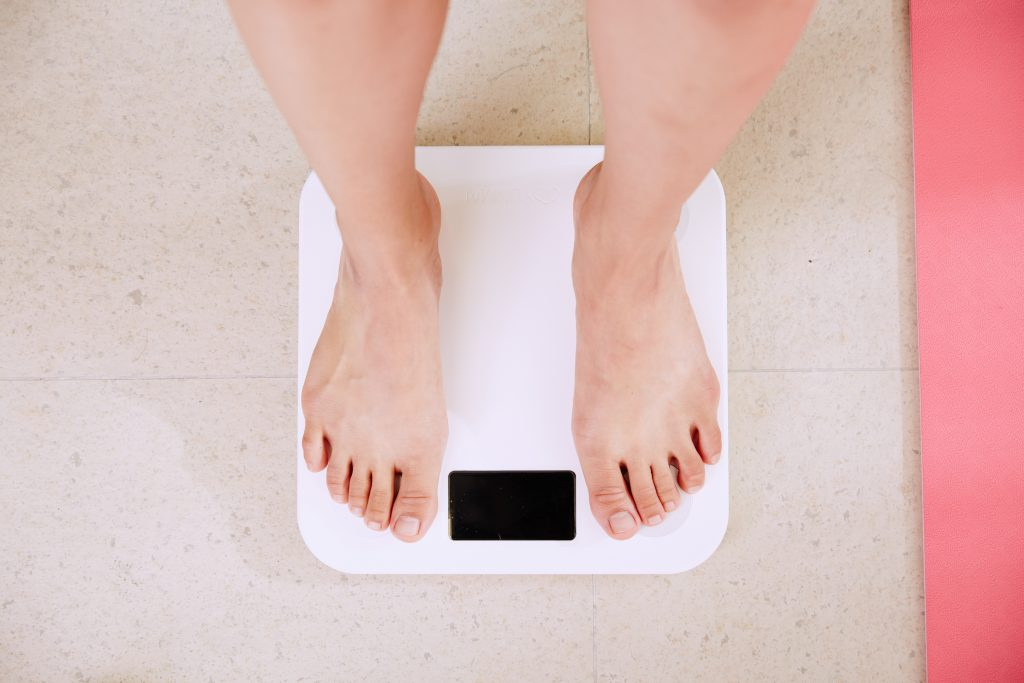 Standing on a weighing scale, Eye Doctor in Dallas, TX
