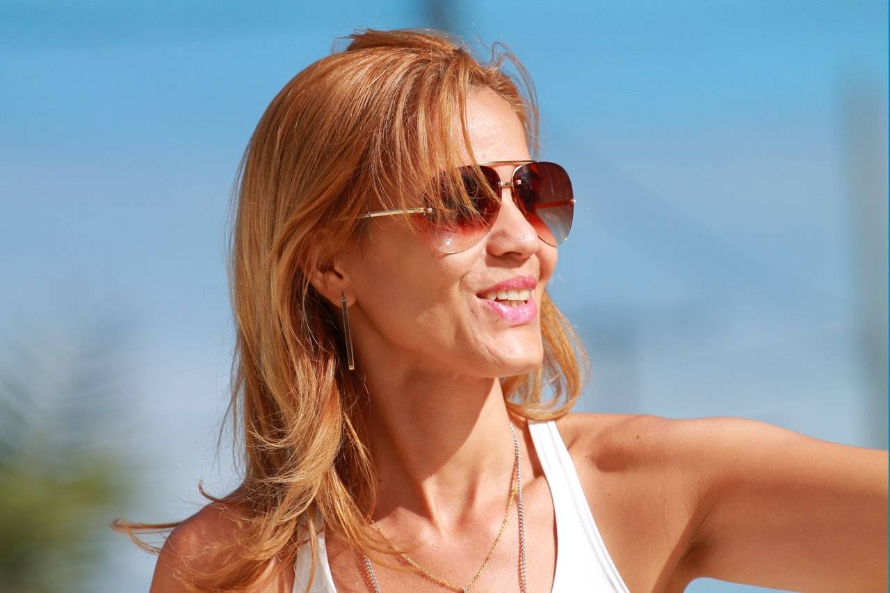 Woman wearing a sun glasses, Optometrist in Dallas, TX